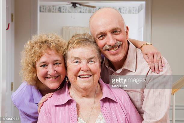 Portrait of a happy elderly mother with her daughter and daughter's husband