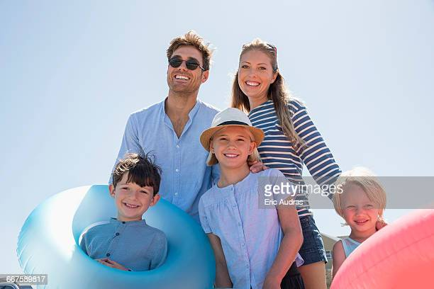 Portrait of a happy family enjoying on the beach