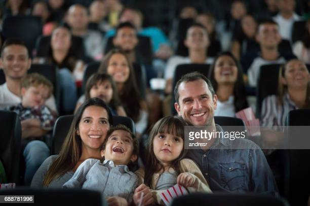 Portrait of a happy family having fun at the cinema