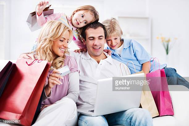 Portrait of a happy family having online shopping.