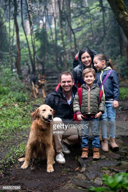 Portrait Of A Happy Family Hiking Outdoors