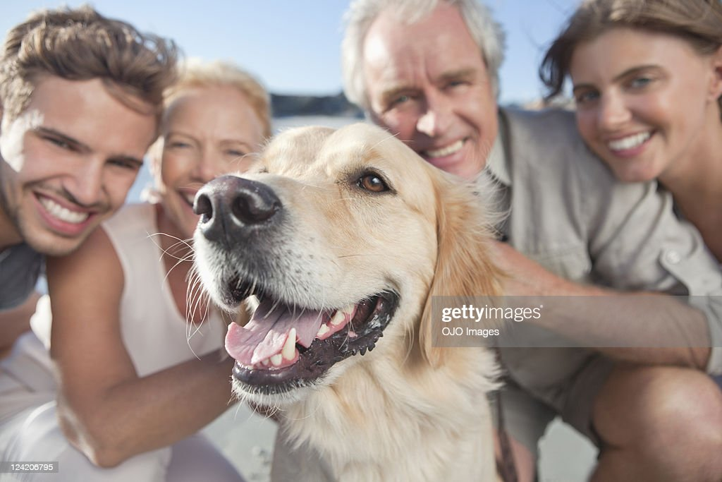 Portrait of a happy family with pet dog : Stock Photo