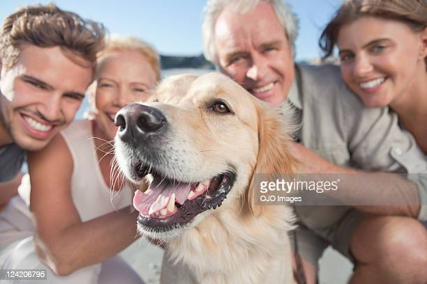 Portrait of a happy family with pet dog