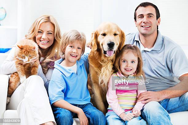 Portrait of a happy family with pets