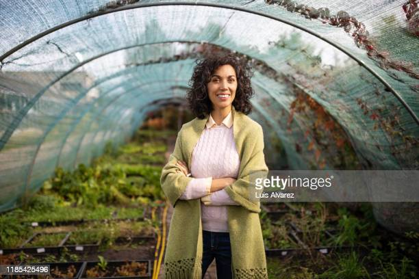 portrait of a happy garden center owner - part of a series stock pictures, royalty-free photos & images