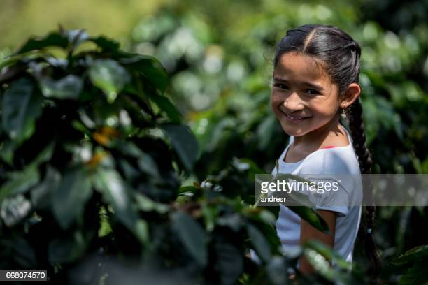 Portrait of a happy girl at a coffee farm