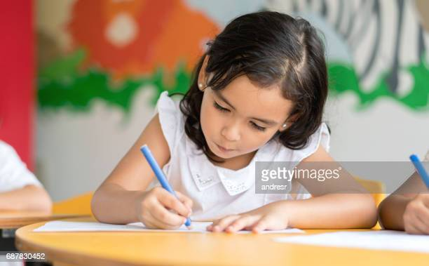 portrait of a happy girl at school coloring - colouring stock pictures, royalty-free photos & images