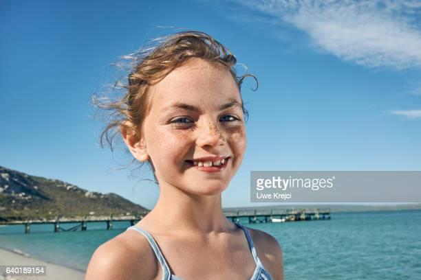 Portrait of a happy girl on beach