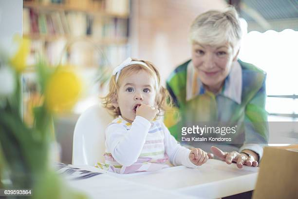 Portrait of a happy grandmother and her granddaughter