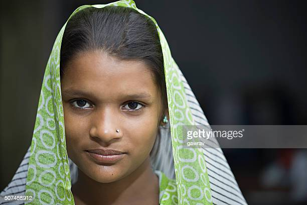 portrait of a happy indian traditional teenage girl wearing dupatta. - indian beautiful girls stock photos and pictures