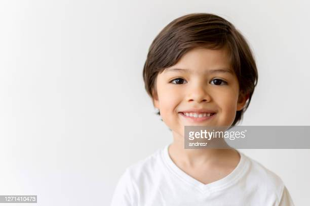portrait of a happy latin american boy smiling - boys stock pictures, royalty-free photos & images