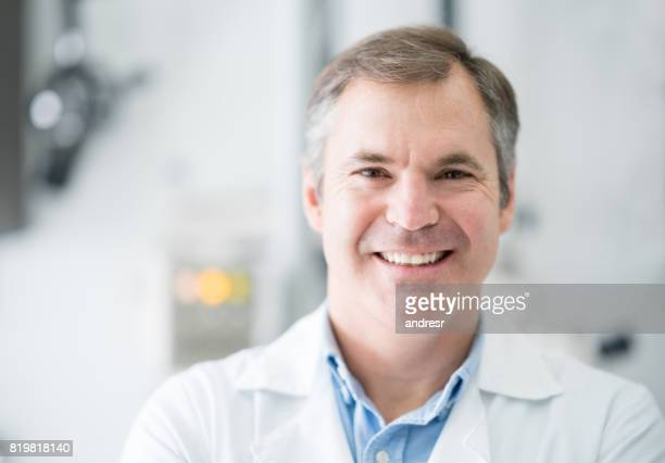 Portrait of a happy male dentist at the office