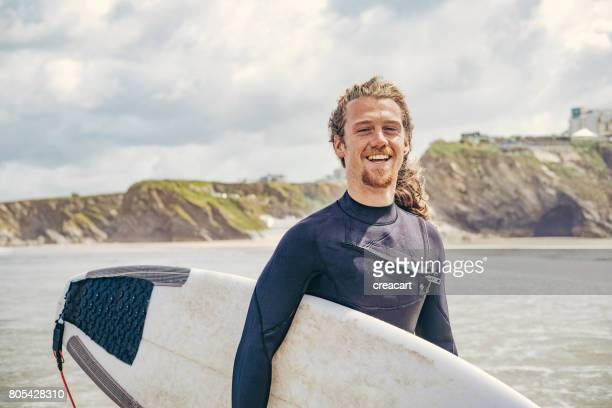 portrait of a happy male surfer, newquay, cornwall - newquay stock pictures, royalty-free photos & images