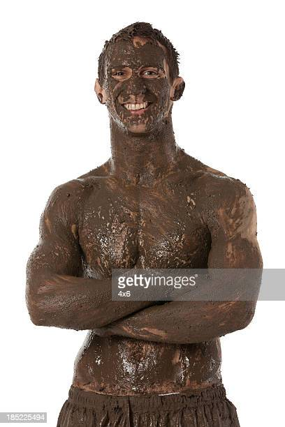 Portrait of a happy man with mud spa