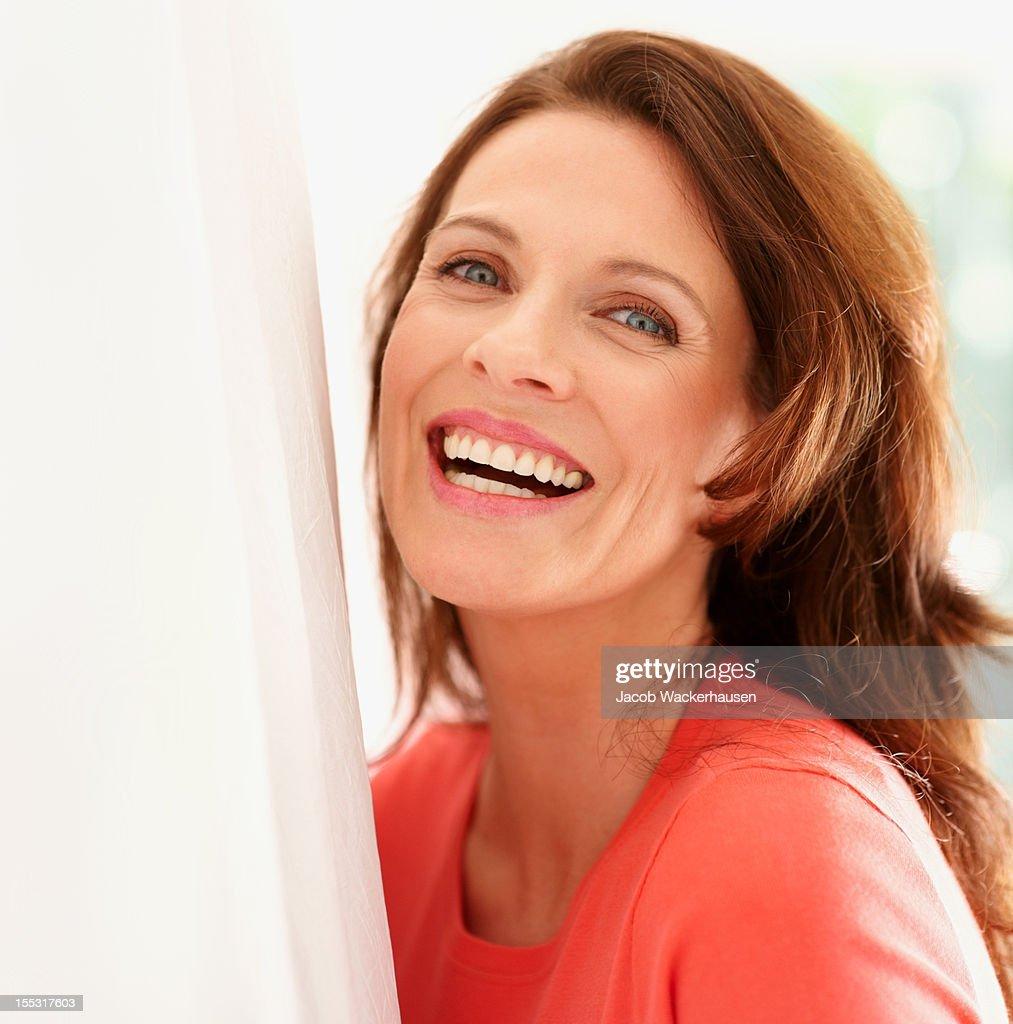 Portrait of a happy mature lady : Stock Photo