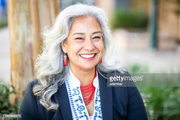 portrait of a happy mexican businesswoman - headshot stock pictures, royalty-free photos & images