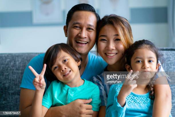 portrait of a happy multi racial asian family - part of a series stock pictures, royalty-free photos & images