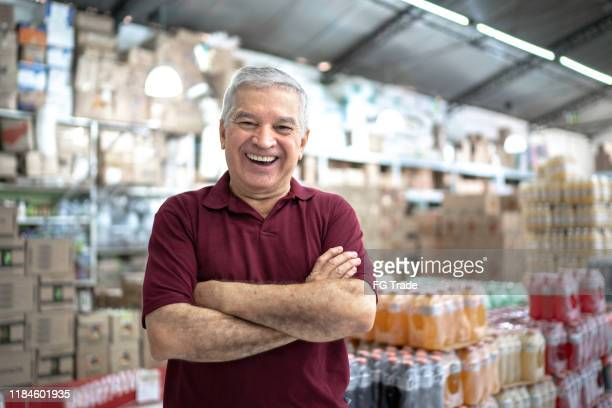 portrait of a happy owner senior at wholesale - market retail space stock pictures, royalty-free photos & images