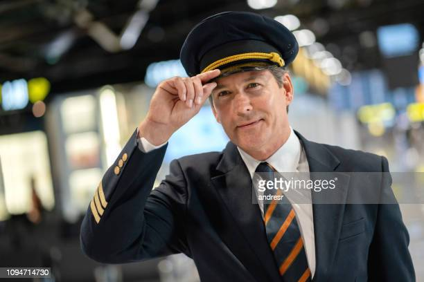portrait of a happy pilot at the airport - aviation hat stock photos and pictures