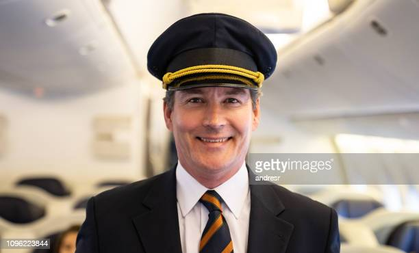 portrait of a happy pilot in an airplane - aviation hat stock photos and pictures