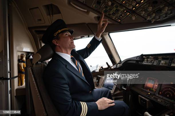 portrait of a happy pilot in the airplane's cockpit - aviator's cap stock pictures, royalty-free photos & images