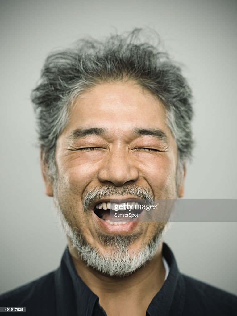 Portrait of a happy real japanese man with grey hair. : Stock Photo