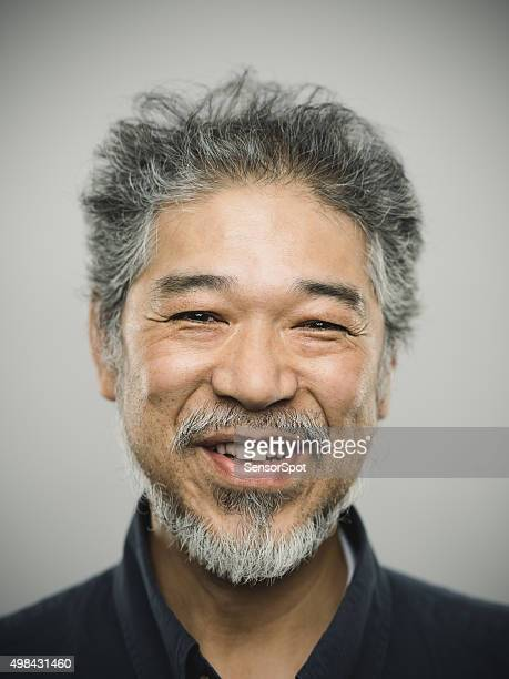 portrait of a happy real japanese man with grey hair. - chinese culture stock pictures, royalty-free photos & images