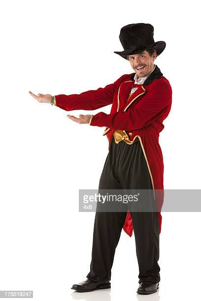 Portrait of a happy ring master gesturing