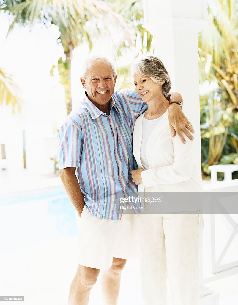 Portrait of a Happy Senior Couple Standing Together on a Porch : Stock Photo