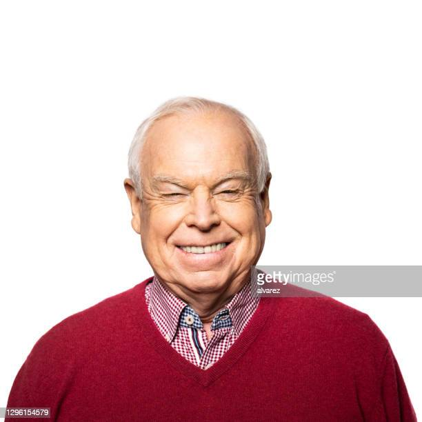 portrait of a happy senior man smiling white background - cardigan sweater stock pictures, royalty-free photos & images