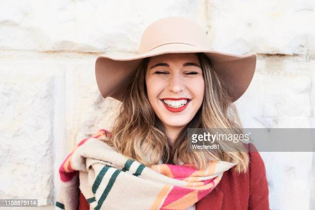 portrait of a happy stylish woman wearing a floppy hat - beautiful women stock pictures, royalty-free photos & images