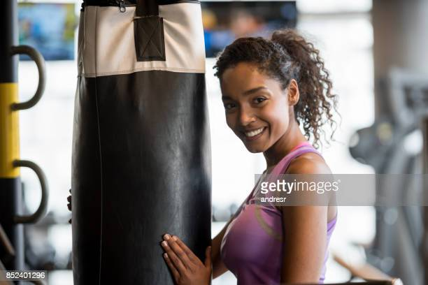 Portrait of a happy woman at the gym boxing