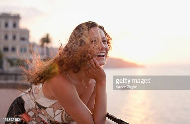 portrait of a happy woman at windy lookout