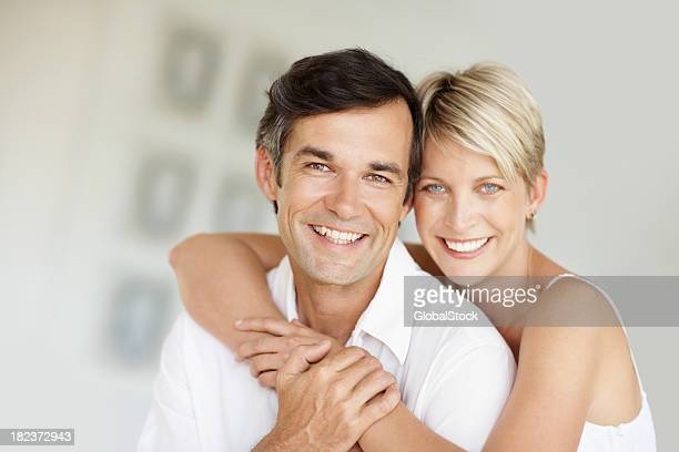 Portrait of a happy woman embracing her husband