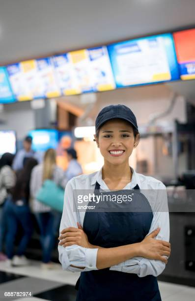 Portrait of a happy woman working at the movies