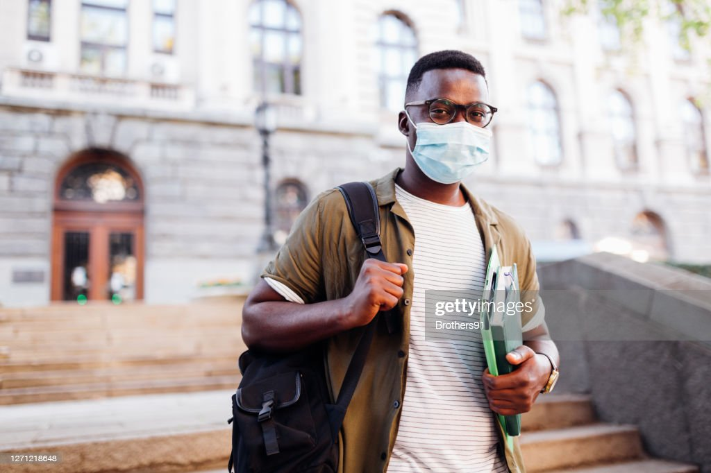 Portrait of a happy young African American male student : Stock Photo