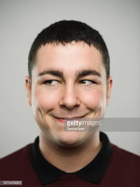 portrait of a happy young caucasian man looking away. - travessura imagens e fotografias de stock
