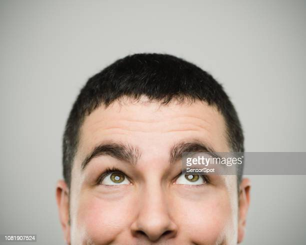 portrait of a happy young caucasian man looking up - looking up stock pictures, royalty-free photos & images