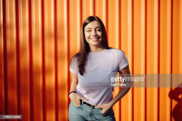 portrait of a happy young caucasian woman posing - fashion collection stock pictures, royalty-free photos & images
