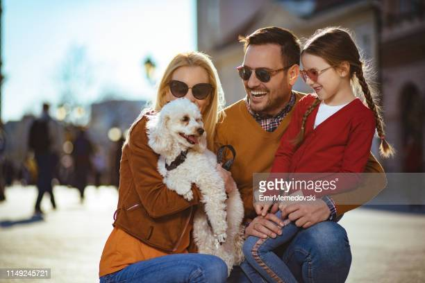 Portrait of a happy young family having fun outdoors