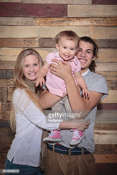 portrait of a happy young family - heshphoto stockfoto's en -beelden