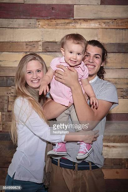 portrait of a happy young family - heshphoto photos et images de collection