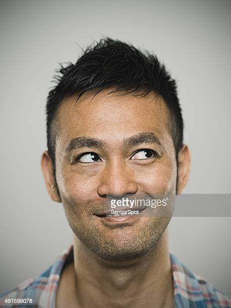 Portrait of a happy young japanese man
