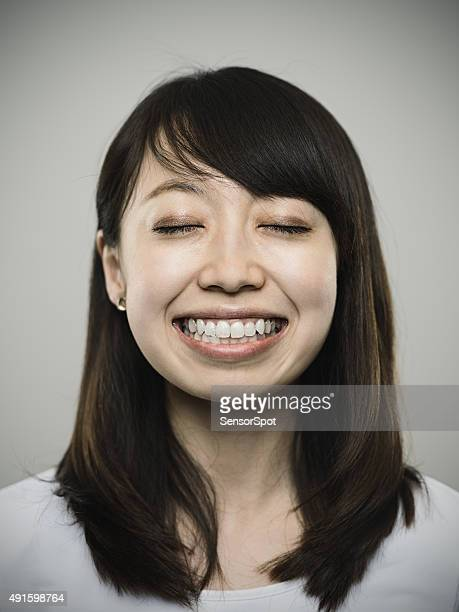 Portrait of a happy young japanese woman looking at camera