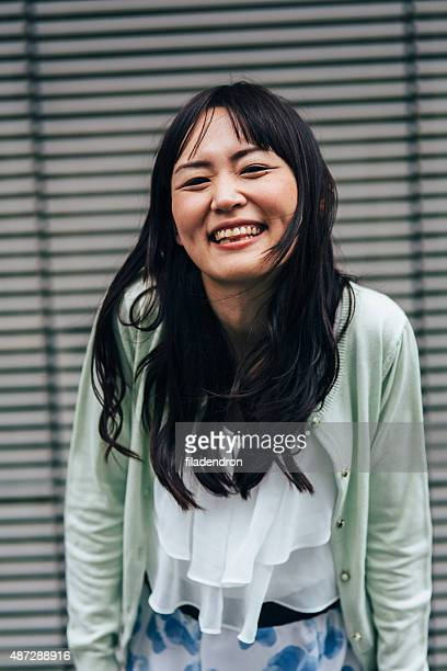 Portrait of a happy young japanese woman