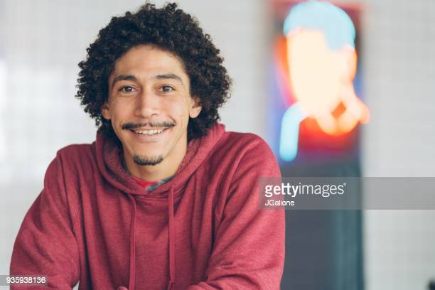 portrait of a happy young man - permed hair stock photos and pictures