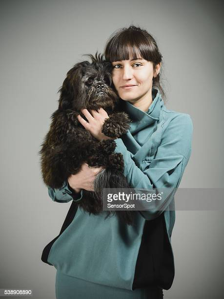 Portrait of a happy young woman with her dog