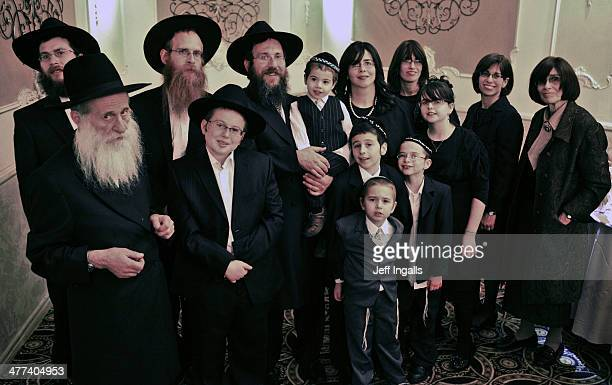 CONTENT] Portrait of a Hassidic family celebrating a bar mitzvah of their oldest son