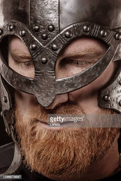 portrait of a helmet wearing redhead warrior king - historical clothing stock pictures, royalty-free photos & images