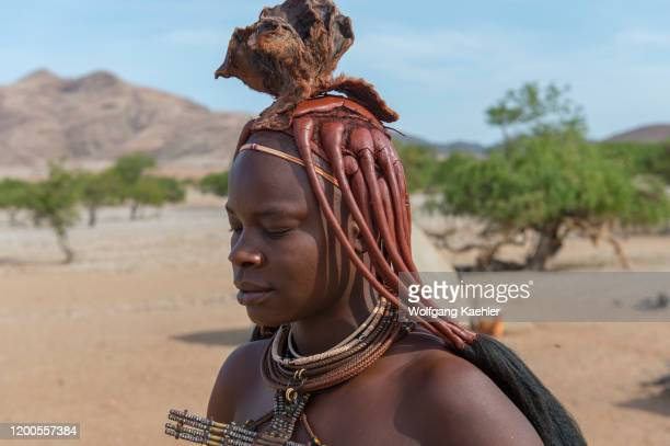 Portrait of a Himba woman in a Himba settlement in the Damaraland of northwestern Namibia.